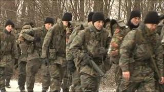 Swiss army recruits marching in forest