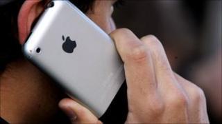 Man using iPhone, Getty