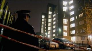Police officer outside Heron House, on the Pelican Estate, Peckham