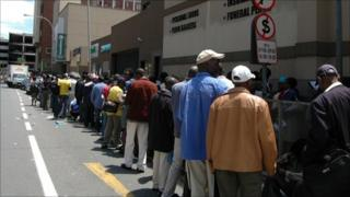 Thousands of Zimbabwe migrants outside a Home Affairs office in Johannesburg queuing for permits, December 2010