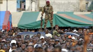 An Ivory Coast soldier stands guard during a pro-Gbagbo rally held by youth leader Charles Ble Goude
