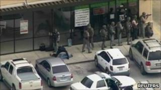 Swat team outside the Texas Bank