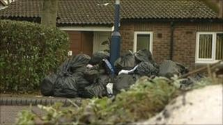 Bin bags waiting to be collected in a street in Stirchley