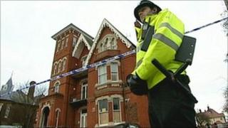 Police stand guard outside the crime scene in Great Yarmouth