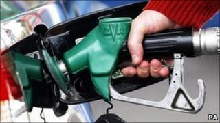 Motorist filling his car with petrol