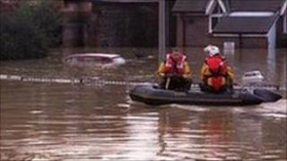 RNLI rescuers attend to floods in Lewes in October 2000