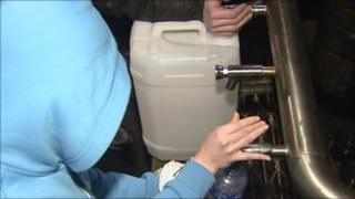 Person filling water container
