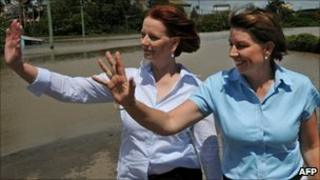 Queensland Premier Anna Bligh (right) and Australian Prime Minister Julia Gillard inspecting some of the flood damage