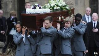 Dale Roberts' coffin is carried from the church
