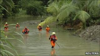 Rescue workers search for bodies near Les Abymes, Guadeloupe