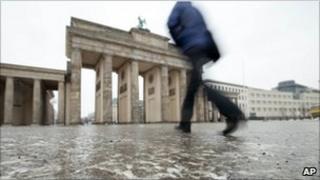 Pedestrian on ice by the Brandenburg Gate, Berlin (6 January 2011)