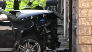 The black Audi hit a property
