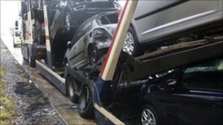 The damaged cars on the transporter