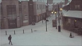 Snow in Wrexham town centre on Friday, 0845 GMT