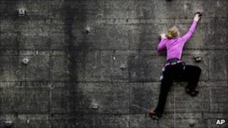 Young woman on an indoor climbing wall