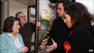 Labour leader Ed Miliband meets Labour voters in Oldham while canvassing with local candidate Debbie Abrahams