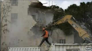 Israeli bulldozers demolish the Shepherd Hotel in Sheikh Jarrah, east Jerusalem, 9 January