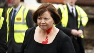Irish minister for health Mary Harney with paint on her neck and face