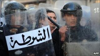 Riot police stand guard in Tunisia