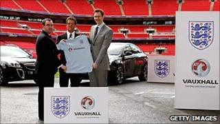 England manager Fabio Capello (C) with FA General Secretary Alex Horne (L) and Vauxhall Managing Director Duncan Aldred (R) at launch or deal