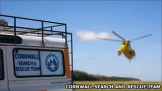 Helicopter and Cornwall Search and Rescue Team vehicle