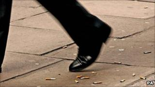 Man walking over cigarette ends
