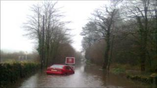 A car stranded in flood water on the A487 near Machynlleth in north Wales