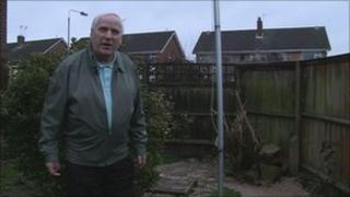 Paul Williams with the raw sewage in his garden