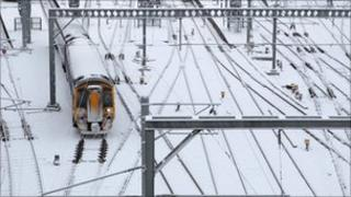 train in snow at Waverly Station