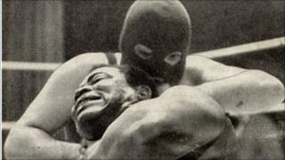 Dr Death taking on Prince Kumali in a wrestling match