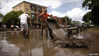 Residents remove mud from houses in the Brisbane suburb of Westend on 14 Jan 2010