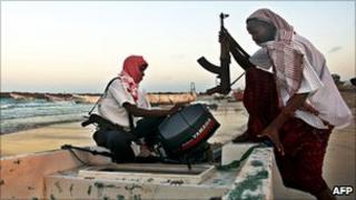 Somali pirates with skiff (file pic)