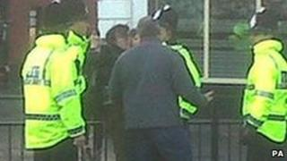 Police with protesters during David Cameron's visit to Newcastle