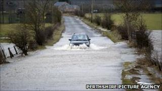 Car driving through flooded road