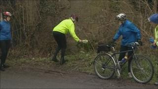 Stroud Valley Cycle Club members lay flowers
