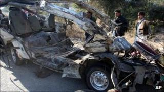 Remains of bombed minibus near Hungu in Pakistan on 17 January 2011