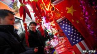 US and Chinese flags are seen at a Chinese new year merchandising market in downtown Shanghai