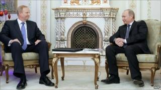 Russian Prime Minister Vladimir Putin (right) speaks with BP chief executive Bob Dudley