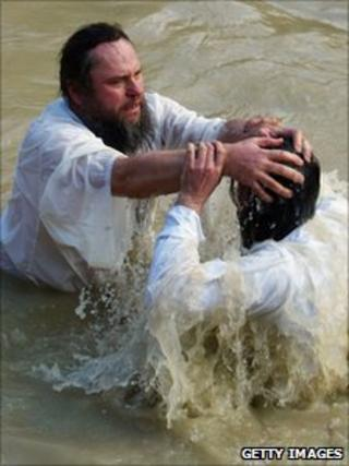 Russian Orthodox priest baptises pilgrim in River Jordan (January 2006)