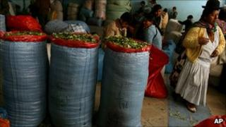 Sacks of coca leaf and indigenous women at a market in La Paz, Bolivia, March 2007