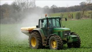 Tractor spreading fertiliser