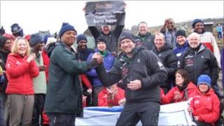 Andrew Fairlie (front right) congratulates climbers at the top of Mount Kilimanjaro
