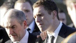 Michaela McAreavey's father, Mickey and husband, John at her funeral