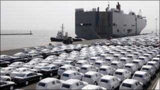 New VW cars wait to get loaded onto transport ships