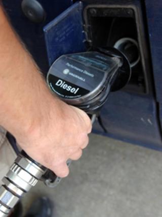 A motorist fills his van with diesel