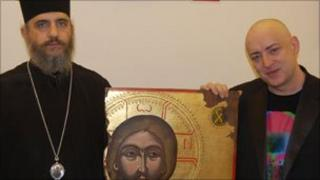 Boy George (r) with Bishop Porfyrios of Neapolis and the Christ icon. Photo by John Kaponi