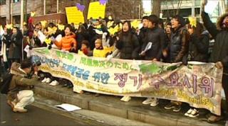 Protesters outside the Japanese embassy in Seoul