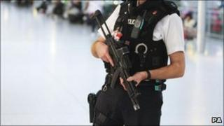 Armed police officer at Heathrow airport