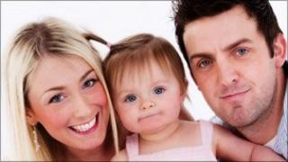 Cpl Jamie Kirkpatrick with his wife Heidi and daughter Holly