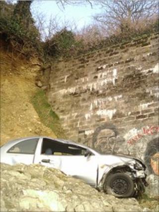 Car on rocks